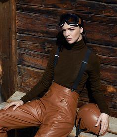 Hermès - Vestiaire d'Hiver 2013. Ski trousers in caramel calfskin, roll-neck jumper in bronze cashmere, helmet covered in caramel calfskin. #hermes #fashion #skiwear