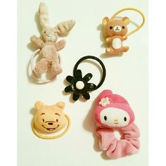 Cute Hair Elastic They can be great gifts for kids or young tennagers who loves these characters. Hair Elastic bought directly from China. There's a bunny, plastic flower, teddy, Pooh Bear, and melonie. They are fairly new and in great shape. The only thing is that teddy elastic has been a bit stretched. Accessories Hair Accessories