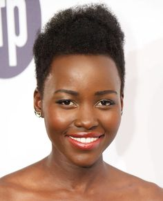 Lupita Nyong'o continues to prove the power of the pixie, whether she's rocking a sparkling hair accessory or embracing her voluminous curls as pictured here.