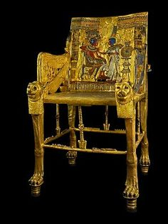 Golden throne of Tutankhamun, it's built of multiple pieces of wood and the entire chair has been covered with gold, inlaid with semiprecious stones, and colored glass.
