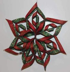Sewing Fabric Fabric Snowflake - These fabric snowflakes are wonderful decor for your house this winter. This video and photo tutorial shows how to make a no sew fabric snowflake. Folded Fabric Ornaments, Quilted Christmas Ornaments, Christmas Sewing, Fabric Christmas Decorations, Paper Ornaments, Homemade Christmas Gifts, Handmade Christmas, Christmas Diy, Oragami Christmas