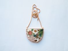 Flowers and algae necklace