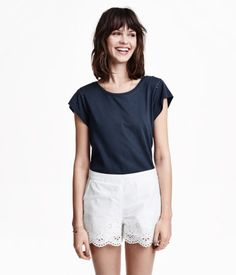 Short-sleeved jersey top in a cotton blend with hemstitch embroidery around shoulder seams. Slightly longer at back.