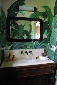 The infamous Beverley Hills Hotel Palm Wallpaper adds a jungle feel to this vanity.