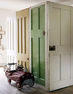 Reclaimed doors used as walls ... What A Great idea!