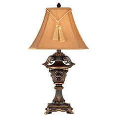 This stylish bronze table lamp makes an eye-catching highlight for any decor or environment. Beautifully crafted with a bronze urn base and a tasseled shade, this stately lamp provides soft lighting and an unforgettable decorative accent.