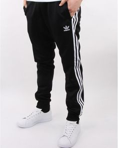 Discover the finest Adidas Originals clothes including the retro 3 stripe t shirt, superstar track top, classic football shorts and more. Adidas Tracksuit, Tracksuit Bottoms, Adidas Jacket, Mens Tracksuit, Adidas Superstar, Black Pants, Adidas Originals, Sportswear, Street Wear