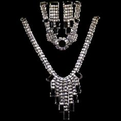 For sale at Retrophoria.com, $75.00 - This is a very elegant silver set with faceted clear and black cut glass.