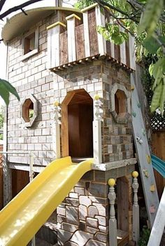 Coolest Castle Tree House from Repurposed Wood. Every tree house should have a slide.