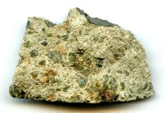 Diogenite meteorite.  This stony achondrite type originates from the deep mantle zone of asteroid Vesta.  It consists of pyroxene and plagioclase crystals embedded in a rocky host matrix.  Diogenites can vary greatly in appearance.  This specimen is a fresh example of the Johnstown meteorite fall.