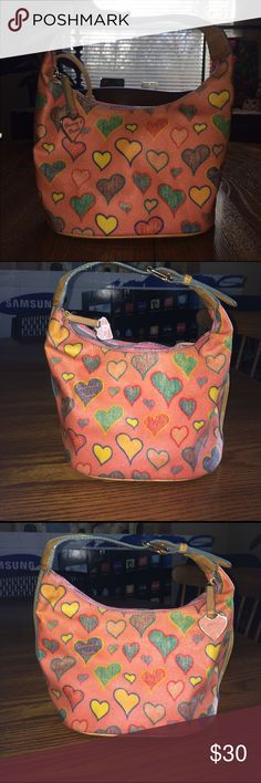 Dooney &Bourke heart 💗 Purse is in  good condition Leather Handel needs little cleaning ▫️ rose pink with multi color heart 💗 Dooney & Bourke Bags Shoulder Bags