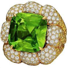 Margot McKinney 28.19ct peridot ring set with white and yellow diamonds.