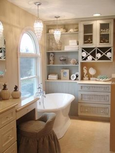 Love chandeliers in the bathroom, built in shelves, claw foot bathtubs, and recessed lighting to make a bathroom wonderfully bright.