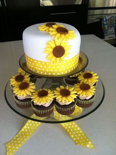 Sunflower cake. Very simple. Do the yellow ribbon in fondant though and the three sunflowers on top of the cake, none on side.