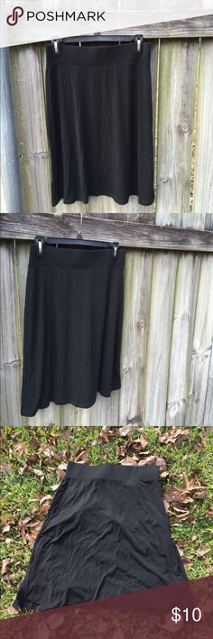 Black Merona Skirt Comfortable yet classy black skirt. Flows nicely. Opaque and thick enough not to need a slip. Great for year round wear! Good used condition. Straight across the waist measures 13.75 inches, and the length is 22.5 inches. Merona Skirts A-Line or Full