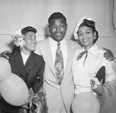"Boxing legend Sugar Ray Robinson (1921-1989) is welcomed home from London on August 1, 1951 by his wife Edna Mae (1915-2002) and his sister Evelyn Robinson Nelson (1919-2009). Mr. Robinson was returning home after a loss to British champion Randy Turpin. He told reporters upon arrival, ""It'll be a different story when I fight Randy Turpin again next month."" He won the rematch against Mr. Turpin just one month later in New York City. Photo: Bettman/Corbis."