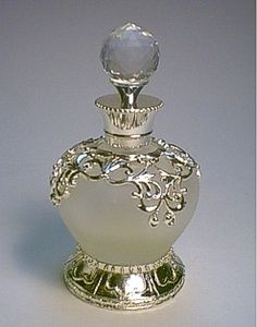 Antique perfume bottle  Cute.  I would fill them up with perfume, dried flowers, color sand, seed beads, glitter...list goes on....