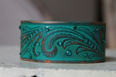 Turquoise Distressed Tooled Leather Cuff with Blue Swarovski Crystals. $27.00, via Etsy.