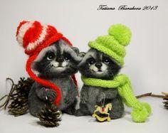 Needle felted raccoons by Tatiana Barakova.