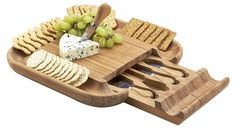 This beautiful bamboo cheese board has a high-capacity cracker serving tray around the entire board and a hidden drawer that stores the four included stainless-steel and bamboo cheese tools....