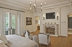 master bedroom decor ideas using wrought iron sconce lighting close to recessed wall tv mount above head statues over moulded fireplace mantels