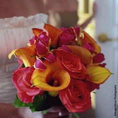 Very colorful wedding bouquet and wedding flower arrangement. #wedding #weddingflowers #weddingbouquets  Photograph by Angie Moon Photography
