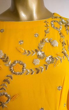 Golden dabka and nakshi work with resham hand embroidery Long flared style sleeves reaching upto mid-thigh Wire pico hemline Zardozi Embroidery, Embroidery On Kurtis, Kurti Embroidery Design, Embroidery Neck Designs, Hand Work Embroidery, Embroidery Fashion, Embroidery Dress, Couture Embroidery, Embroidery Motifs