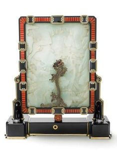 Cartier Art Déco Clock - 1926 - Platinum and gold, onyx crimped, white jade carved (dial), mother of pearl, coral, rose-cut diamonds and bla...