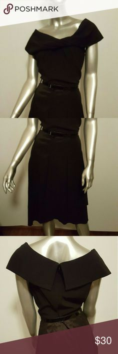 ADRIANNA PAPELL Black Pocketed Office Dress Sz 12 Lovely ADRIANNA PAPELL Dress Size 12  Good condition   Concealed back zipper  Pocketed   Full skirt  Beautiful twisted neckline   Easily goes from day to evening   Fabrication- contrast material /Top-95%Polyester 5%Spandex  Bottom- 60%Polyester 32%Nylon 8% Spandex   Feel free to contact me with any questions or concerns prior to purchase   Thank you for looking in my closet!  kostkutter Adrianna Papell Dresses