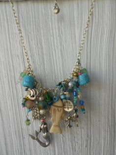 Mermaid wedding necklace series.  My homage to our wonderful salty oceans. Vintage charms, Bali silver, Ghana recycled glass, India glass beads, hand cast Greece silver, sea turtles, ships,  shells,fish, & Greek ceramics, baubles, vintage pearls. One-of-a-kind. Cherish. Love. Custom lovelies welcome!  You so deserve one if you love The Beach, Mermaids, Mermans! , Oceans, Sand, Salt, Beach Bums welcome.