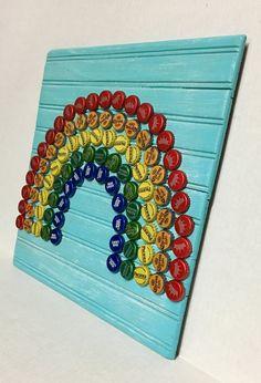 Rainbow Bottle Cap Wall Art Rainbow Bottle Cap Wall Art The post Rainbow Bottle Cap Wall Art appeared first on Craft Ideas. Beer Bottle Top Crafts, Bottle Top Art, Beer Cap Crafts, Bottle Cap Table, Bottle Cap Projects, Diy Bottle, Bottle Caps, Beer Cap Art, Beer Caps