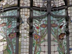 Pretty Art Nouveau stained glass and steel work