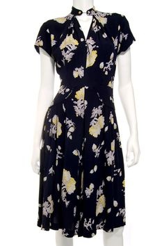 Buttoned up dresses were also stylish at that time. This was worn in Pearl Harbor!