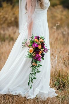Oranges purples and cascading greenery in this autumn wedding bouquet. Oranges purples and cascading greenery in this autumn wedding bouquet. Cascading Wedding Bouquets, Fall Bouquets, Purple Wedding Flowers, Fall Wedding Colors, Bride Bouquets, Autumn Wedding Bouquet, Orange Purple Wedding, Spring Wedding, Garden Wedding