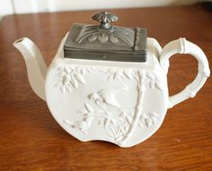 I collect vintage white teapots, kettles and pitchers like this but I don't have this one.
