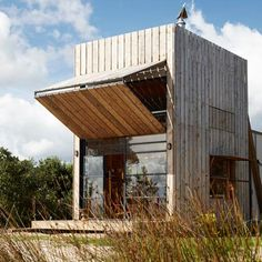 A wooden house-on-sleds by Crosson Clarke Carnachan Architects that can be towed off the beach.