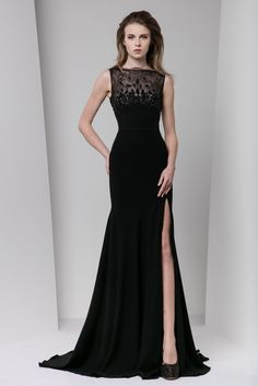 Tony Ward Fall Winter 2016/17: A sexy and classic silhouette. I adore this black dress with a slit and embroidered sheer neckline.
