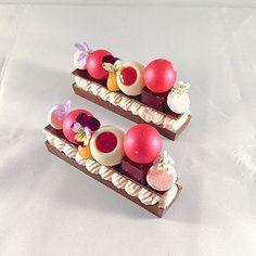 "Raspberry ganache , passion fruit curd, raspberry truffle, hibiscus raspberry jelly, white chocolate whipped nameleka ""BAR' #bachour #bachoursimplybeautiful #theartofplating #chefsofinstagram #chefstalk #gastroart   by Pastry Chef Antonio Bachour"