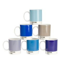 These mugs, inspired by Pantone Color charts, are glazed with a pattern resembling the iconic Pantone Color Chip and come with a Pantone chip tag.  Bone China.  12 oz.  Individual Mugs in the Blue Family.   PA155 Warm Gray 8  PA156 Violet 7672  PA157 Blue 7461  PA158 Heather 5285  PA159 Sky Blue 2728  PA160 Vintage Blue 630