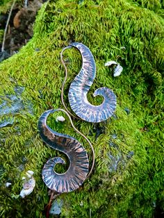 The Copper Crow    fold formed copper spiral earrings