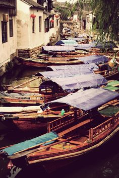 Boats in the canal town of Zhouzhuang, China. A vintage effect used in PS.