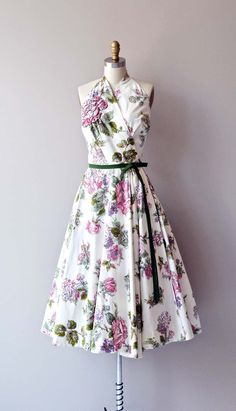 vintage 1950s Lilli Ann cotton floral print wrap dress with trapunto flower with small studded rhinestones at one shoulder, fitted waist, very full circle skirt and green grosgrain bow belt that snaps closed at the waist.