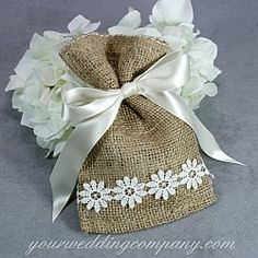 Add a delicate rustic or vintage-themed accent to your wedding with pretty lace.  Use it on candles, invitations, centerpieces, wedding favors, vases and bouquet handles. http://www.yourweddingcompany.com