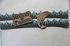 I had another title in the works for fishing, I made a fish to go with it...Creative Memories grass punch.. I cut the waves with my Silhouette, but you could use a circle punch to cut the arcs out of a strip of paper