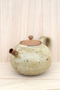 Matt Glazed Beige Teapot. The shape is so cute, it's a personal Teapot. Product sold by simpleandrustic.com