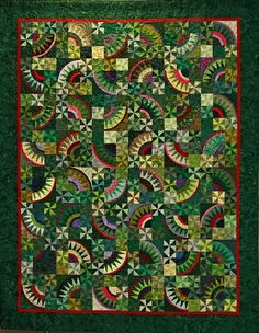Christmas Pickle pattern from Possibilities. I made this quilt three years ago. Also made one using this pattern with Brown and Blues for a color crayon contest. (I drew two color crayons, brown, and blue) Quilting Projects, Quilting Designs, Christmas Pickle, New York Beauty, Quilt Modernen, Green Quilt, Scrappy Quilts, Batik Quilts, Foundation Paper Piecing