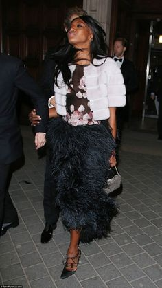 Ciao! Naomi held her head up high as she departed from the west London venue, her clothes ...