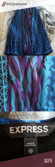 Express spaghetti strap dress Like-new, only worn once! Express patterned dress in great condition.  Has black inner slip lining. Express Dresses