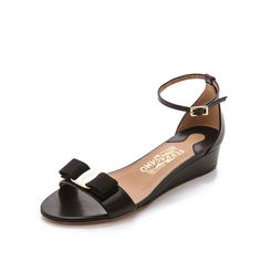 Salvatore Ferragamo Margot Wedge Sandals ($590) ❤ liked on Polyvore featuring shoes, sandals, nero, low heel sandals, ankle wrap sandals, ankle strap sandals, leather shoes and leather ankle strap sandals