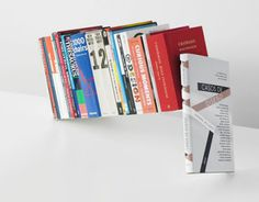 Make your books fly. Whether vertical or horizontal the Fiction book stand turns an ordinary pile of books into a sculptural feature in your home or office.